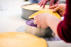 Men in pastry shop bakery making pies and cakes ready stock photo