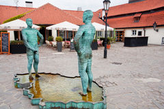 Men pee past entrance of writer Franz Kafka museum Royalty Free Stock Images