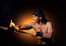 Men performing fire show Stock Photography
