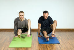 Men Performing Yoga - Horizontal Royalty Free Stock Photos