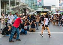 Men photographers are photographing sexy cosplayer. BANGKOK, THAILAND - MARCH 31: Men photographers are photographing sexy cosplayer in Oishi World Cosplay Stock Photos