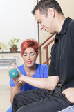 Men at the physio with a dumbell. A men at the physio with a dumbell Stock Image