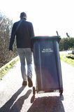 Man with plastic recycle bin Stock Photos