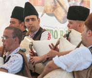 Men play the bagpipes at the Festival of Rozhen 2015 Royalty Free Stock Photos
