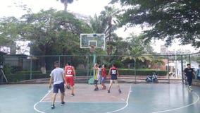 Shenzhen, China: men play basketball as a recreational sport. Royalty Free Stock Photos