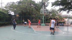 Shenzhen, China: men play basketball as a recreational sport. Stock Photography