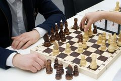 Men play chess. Business and chess royalty free stock photo