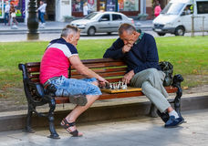 Men play chess. Royalty Free Stock Photos