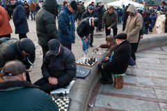Men play chess outdoor on the main square of capital in Kyiv Stock Photo