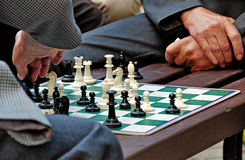 Men play chess Royalty Free Stock Images