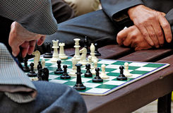 Men play chess Stock Photography