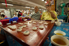 Men play Chinese chess in Chinatown Bangkok. Royalty Free Stock Photography