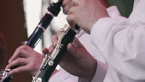 Men play the flute. In the orchestra stock footage