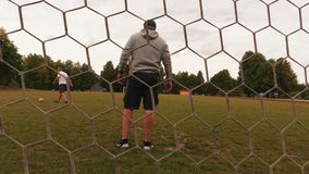 Men play football. In summer day stock video footage