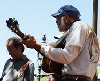 Men play instruments on street during festival Royalty Free Stock Photo