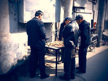 Men play in the street the traditional chinese chess. Royalty Free Stock Photo