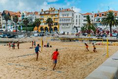 Men play variation between beach volley and beach football known as Futevolei on a beach in Cascais, Portugal. This