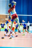 Men play volleyball Stock Images