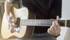 Men Playing Acoustic Guitar Closeup cord Em with sunlight Royalty Free Stock Photography