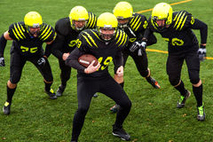 Men playing american football Royalty Free Stock Photography