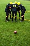 Men playing american football Royalty Free Stock Photos