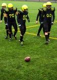 Men playing american football Stock Image