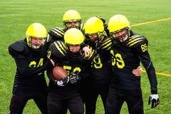 Men playing american football Royalty Free Stock Image