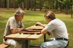 Men playing backgammon Stock Photo