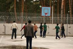 Men playing basketbal. ZHURAVYCHI, UKRAINE - 12 September 2008: Men playing basketball in the temporary residence of foreigners and stateless persons who Royalty Free Stock Photos