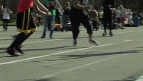 Men playing basketball in a city park. Sequence stock footage