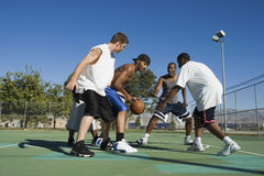 Men Playing Basketball On Court Stock Photo