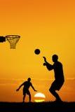 Men playing basketball. Illustration of men playing basketball at sunset Stock Photo