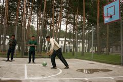 Men playing basketball. ZHURAVYCHI, UKRAINE - 12 September 2008: Men playing basketball in the temporary residence of foreigners and stateless persons who Royalty Free Stock Photo
