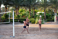 Men playing beach volleyball royalty free stock images