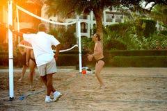 Men playing beach volleyball stock photos
