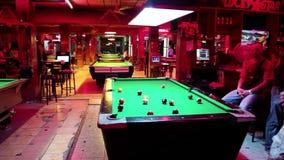 Men playing billiards inside big billiards club stock footage
