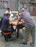 Men are playing board game outdoor in Wuhan, China Stock Photos