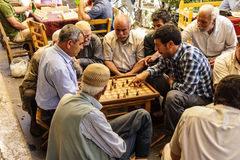 Men playing boardgames Stock Image