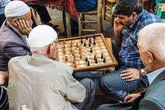 Men playing boardgames Royalty Free Stock Photo