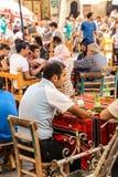 Men playing boardgames Royalty Free Stock Image