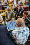 Men playing boardgames Stock Images