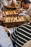 Men playing boardgames Stock Photos