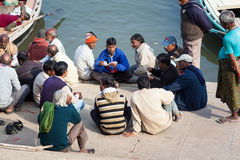 Men playing cards by the Ganges Stock Image