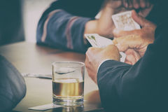 Men playing cards, gambling and drinking alcohol stock photos