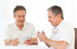 Men playing cards on the table Royalty Free Stock Photo