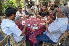 Men playing cards in Urfa in Turkey. Men playing cards in the tea garden at the Urfa (Sanliurfa) bazaar in Urfa in south eastern Turkey Stock Photos