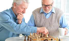 Men playing chess Stock Photography