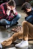 Men playing chess Stock Photos