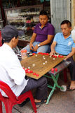 Men playing Chinese chess game Royalty Free Stock Photos