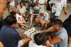 Men playing Chinese Chess on the street in Beijing Stock Photos
